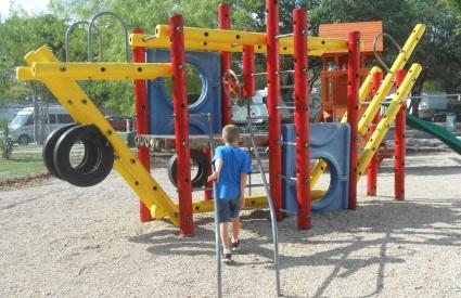 child at playground gym
